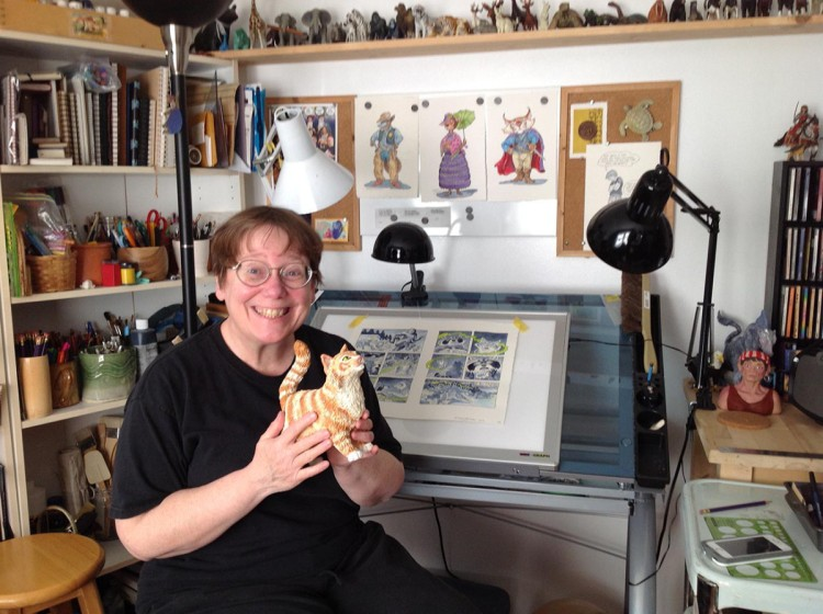 Me in my studio, with my li'l buddy Spam, a polymer clay maquette I made of the protagonist of Spam and the Sasquatch.